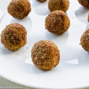 Close up view of donut holes on white plate