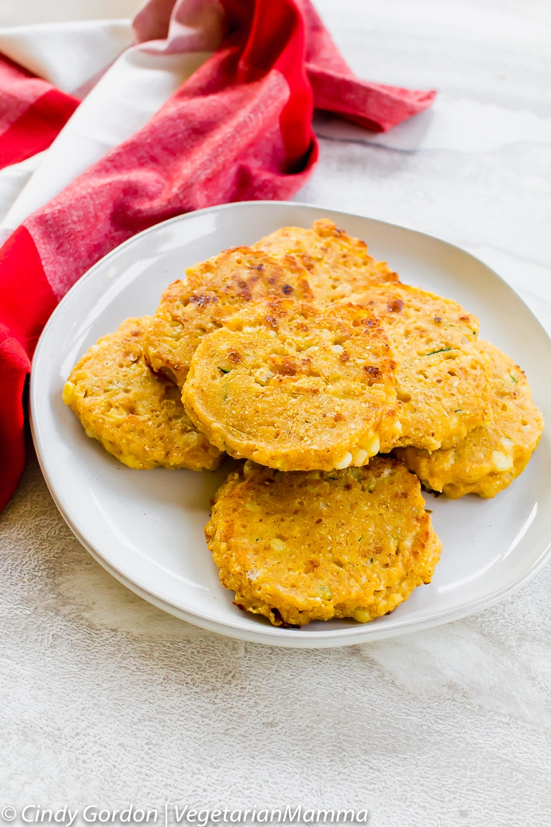 Zucchini corn Cakes or Zucchini Fritters can be served plain or with sour cream and chives.