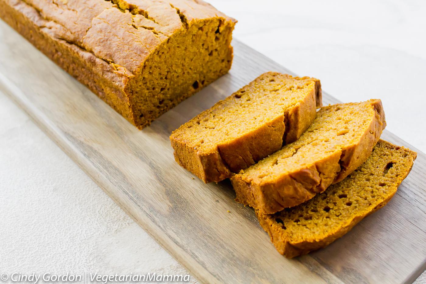 Gluten Free Pumpkin Bread sliced on a cutting board