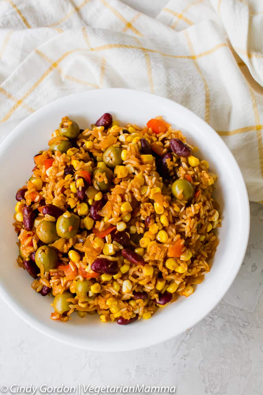 Spanish Rice with olives served in a white bowl