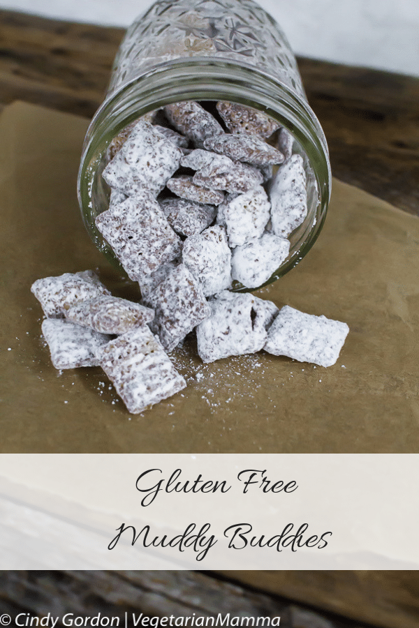 Mason Jar of Gluten Free Puppy Chow tipped oer