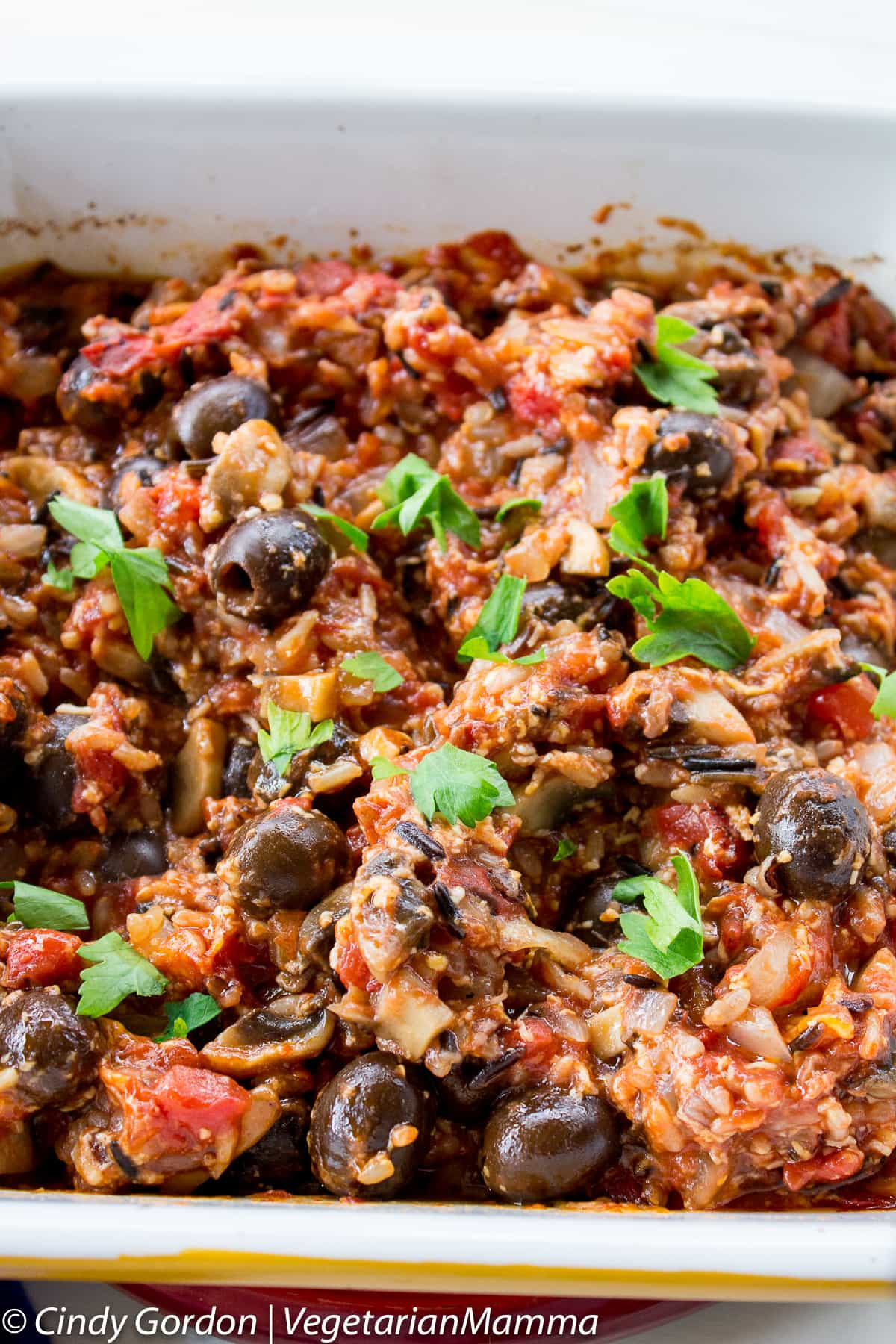 Wild Rice Mushroom Casserole topped with fresh parsley