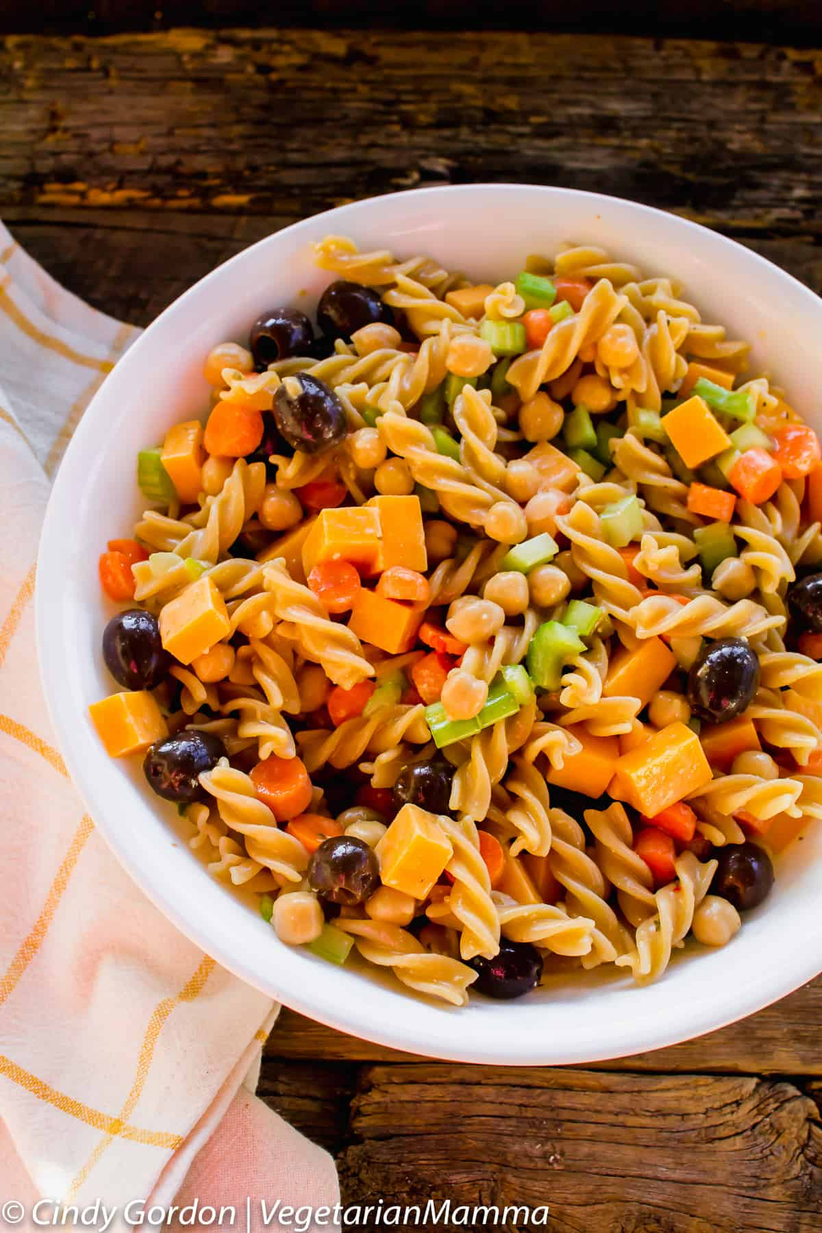 summer pasta salad, gluten free and served in a white bowl
