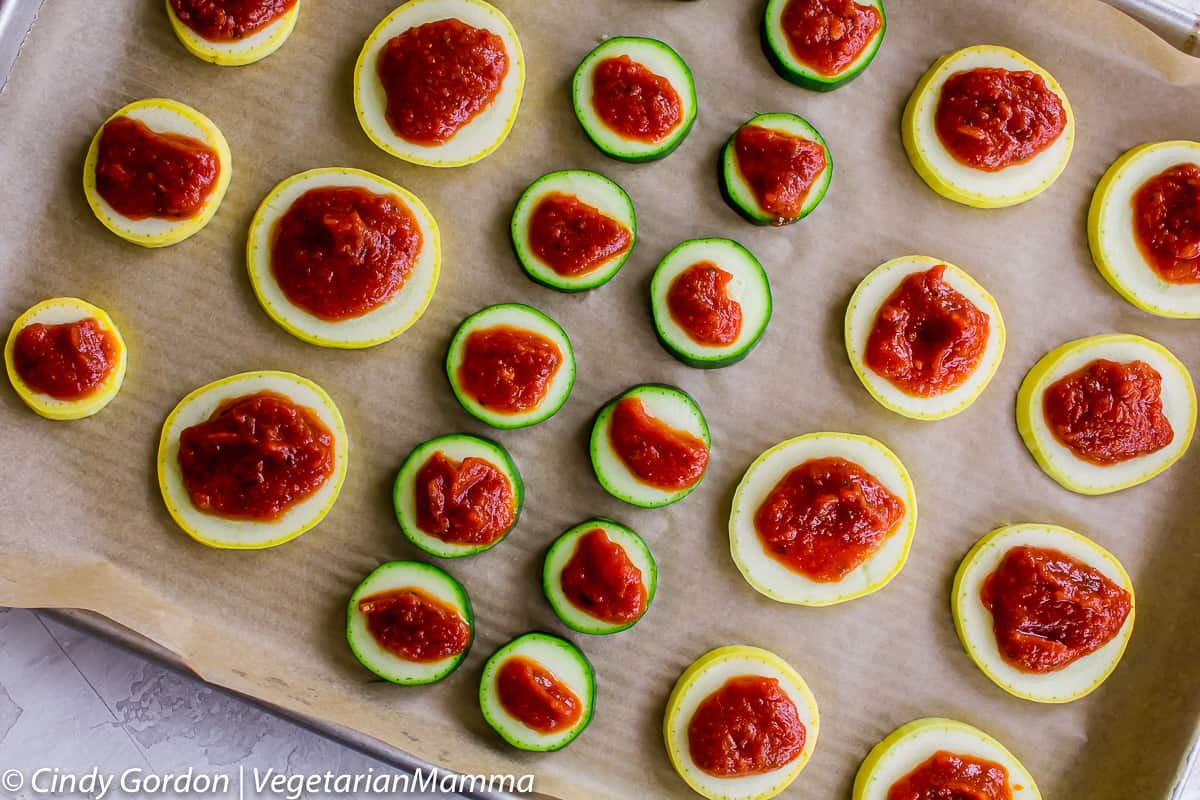 Yellow Squash and zucchini with tomato paste on top.