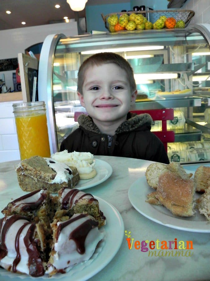 son enjoying the gluten free desserts from Cherbourg Bakery