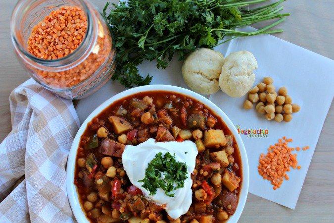 bowl of lentil stew surrouded by lentil stew ingredients