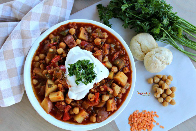 bowl of vegetarian lentil stew surrounded by ingredients