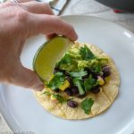 black bean taco getting lime juice squirted on it