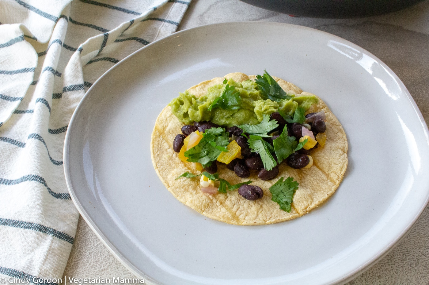 black bean taco on a white plate