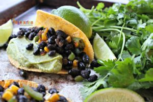 Black Bean and Guacamole Tacos @vegetarianmamma.com with lime juice