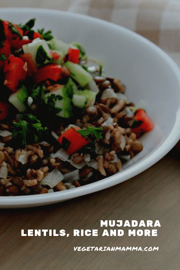Lentils and rice topped with dice tomatoes and cumbers in a white bowl - Mujadara