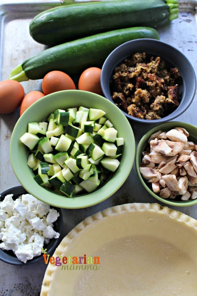 Ingredients for gluten-free zucchini quiche - eggs, zucchini, vegan sausage and mushrooms