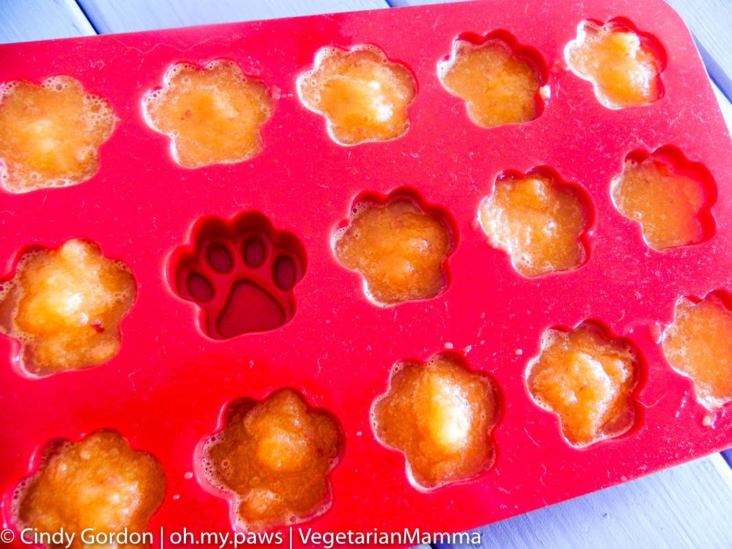 Frozen carrot apple cubes in a silicone mold