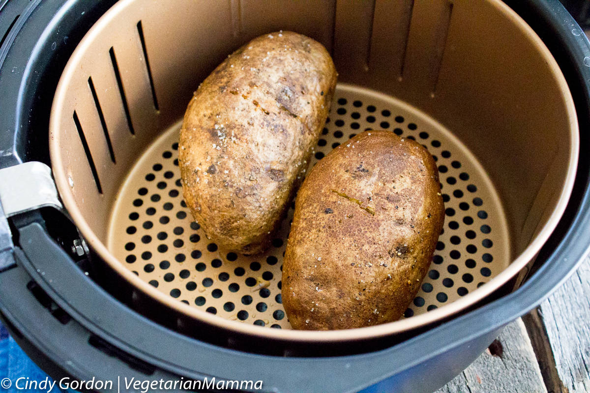 two whole baking potatoes in an air fryer