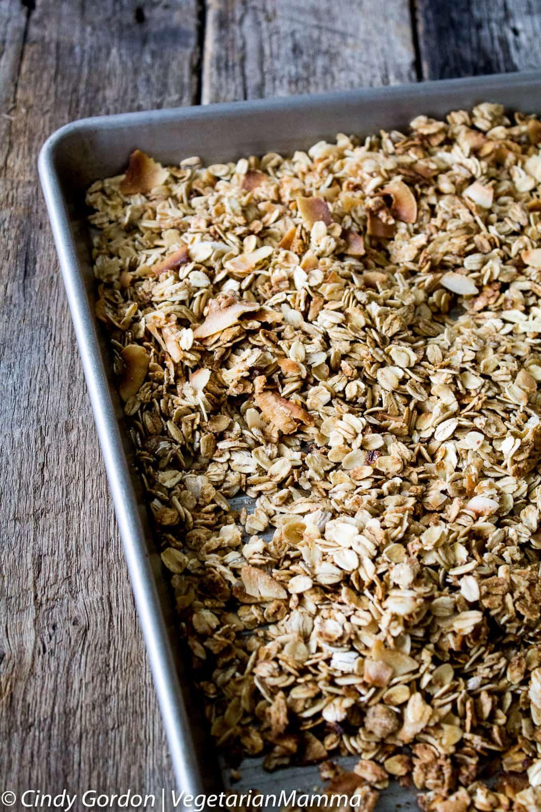 baked homemade granola on baking sheet