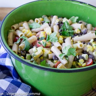Easy Taco Pasta Salad inside of green pot beside blue and white cloth