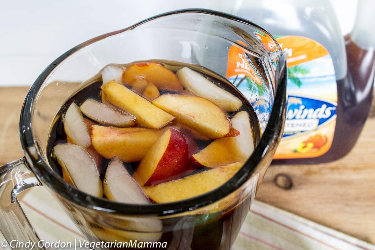 Easy Summer Peach Tea Punch is the perfect beverage to sip on a hot summer day. This crowd pleasing iced tea punch recipe will easily become your favorite.