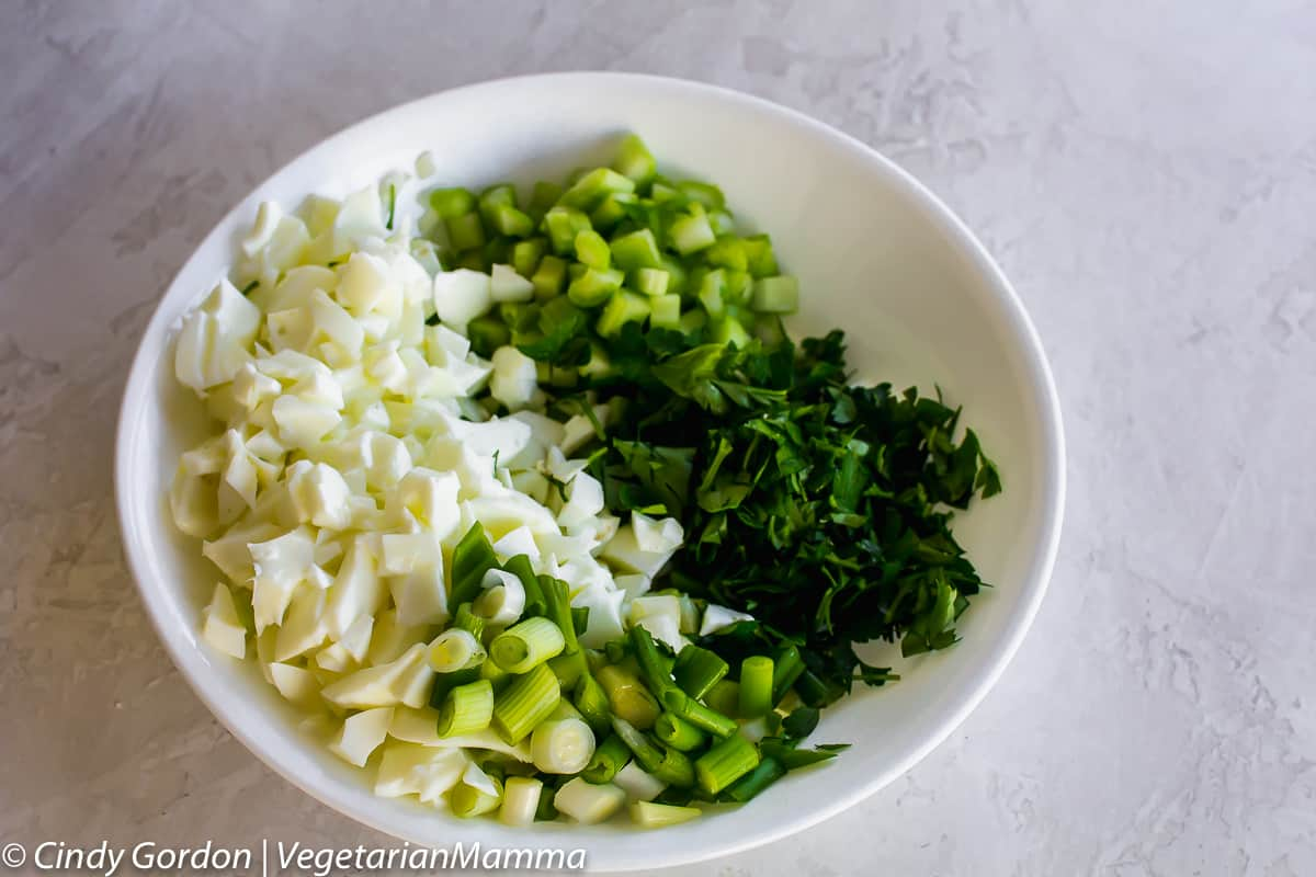 eggs, onions, parsley, and celery for gluten-free deviled egg pasta salad