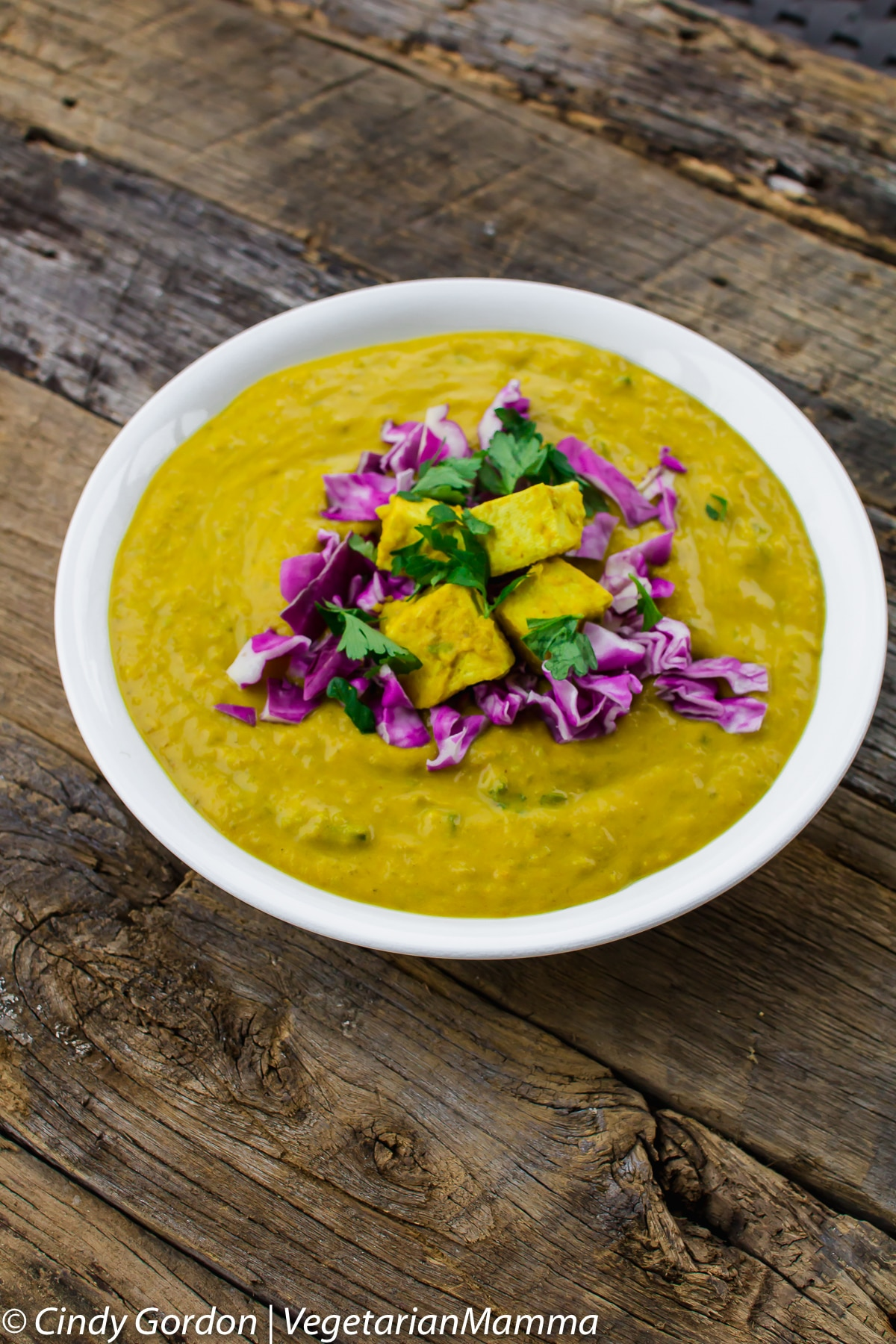 Vegan Coconut Curry soup is full of bright inviting flavors and colors.