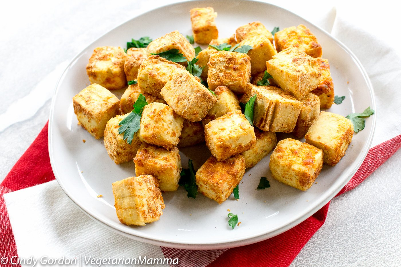 plate of Crispy Air Fryer Tofu with fresh parsley sprinkled over
