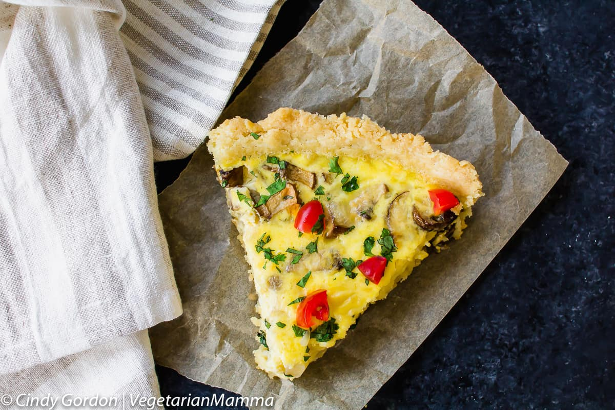 Single peace of gluten free quiche with a simple scratch crust.