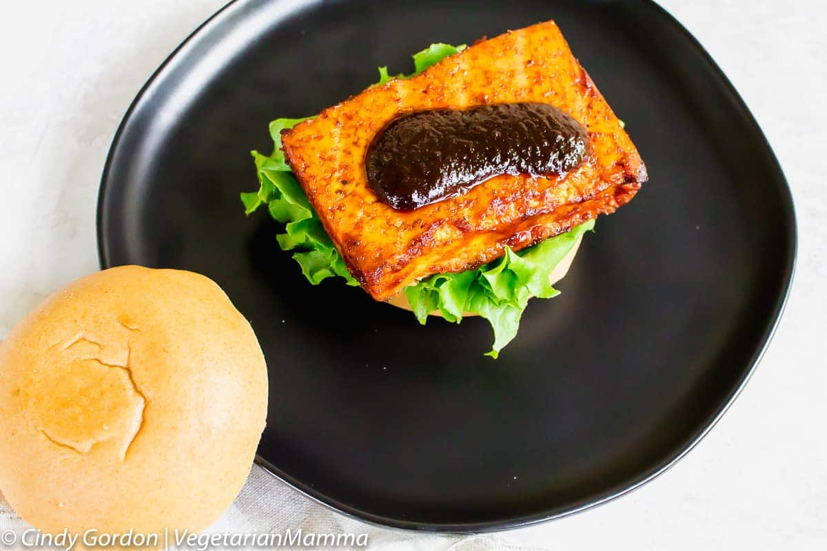 Slather on some extra bbq sauce to your grilled tofu burger.
