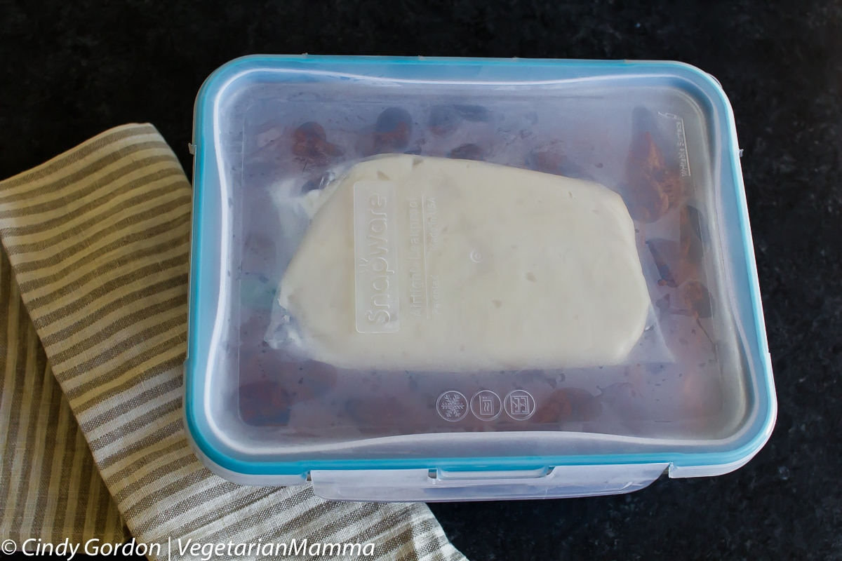 Freezer container full of cinnamon roll french toast casserole.