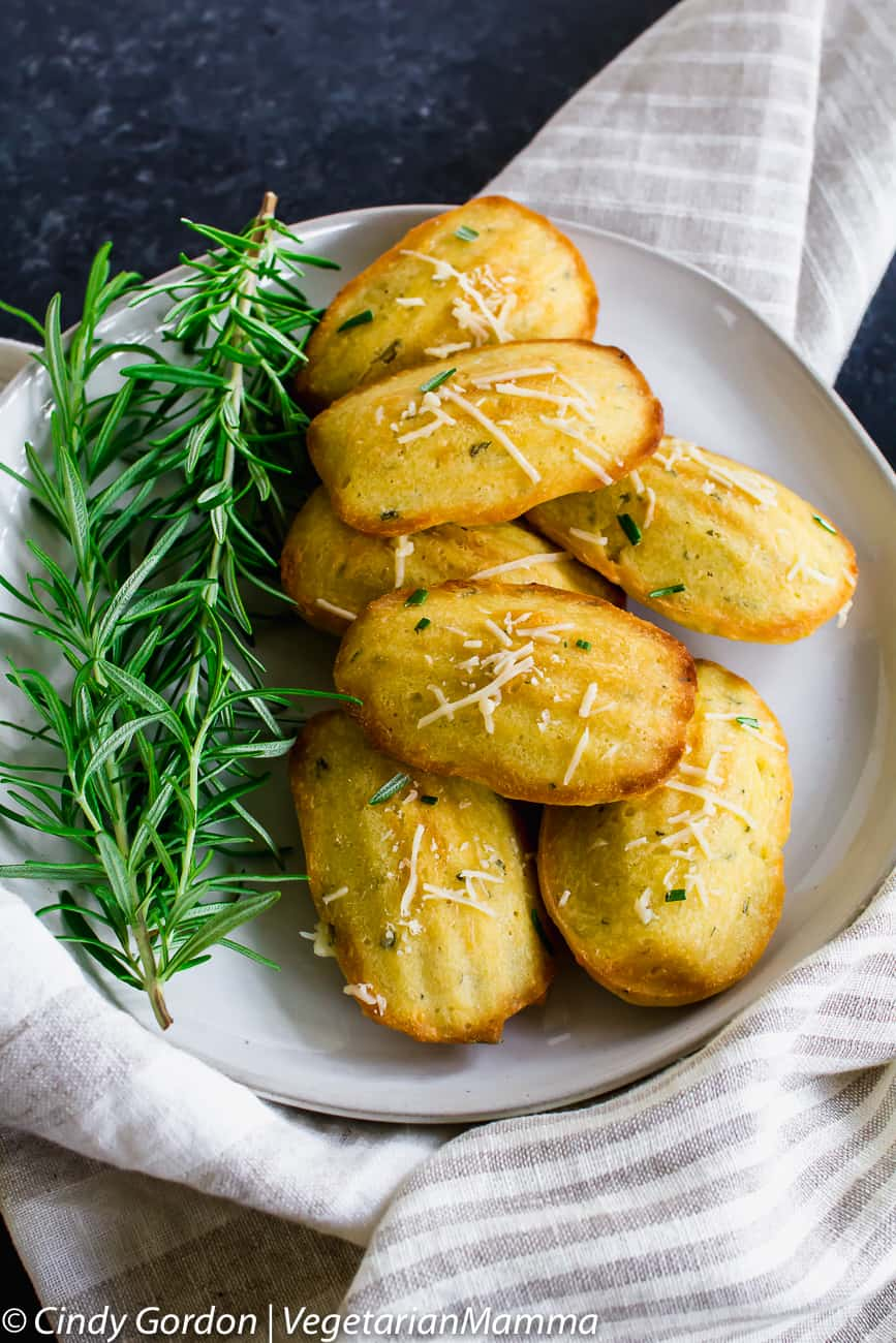Gluten Free Madeleines with rosemary and parmesan are a delicious and savory golden brown mini sponge cake treat