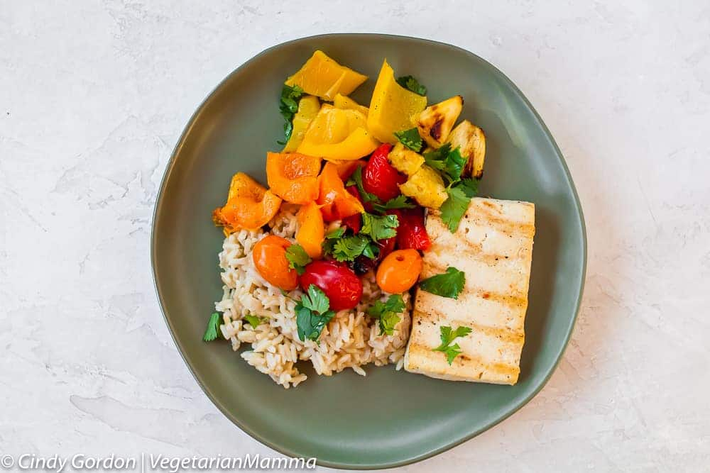 Healthier Grilled Sweet and Sour Tofu with Vegetables served on a green plate.