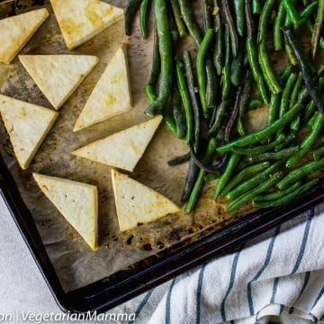Lemon Tofu and beans on sheet pan with striped cloth