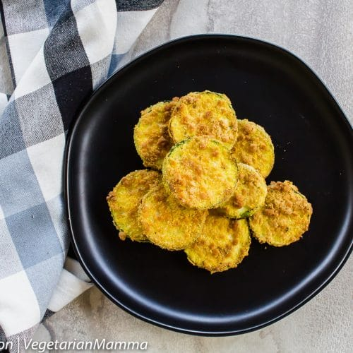 Top down view of Air Fryer Zucchini Coins atop black plate