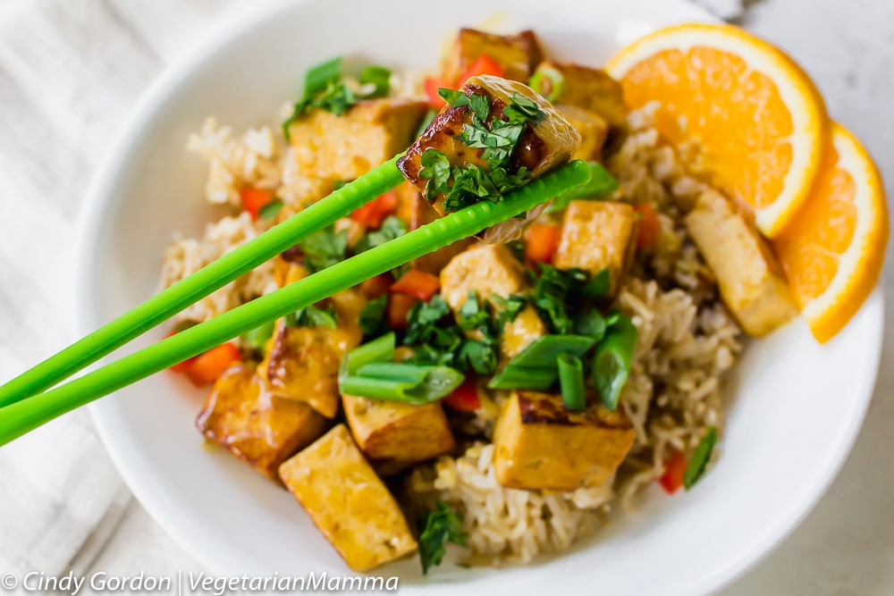 Orange Tofu with green chopstix
