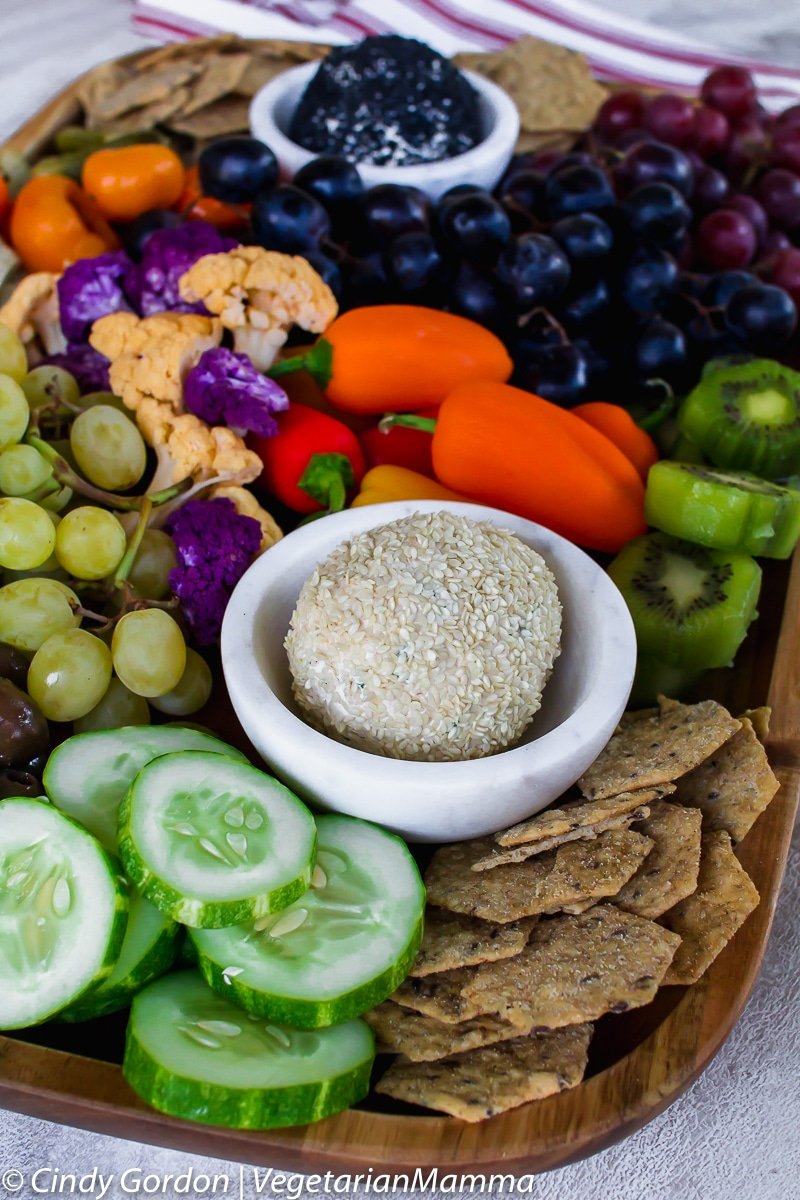 Vegetarian Charcuterie boardw with cheese ball and assortment of fruits and veggies