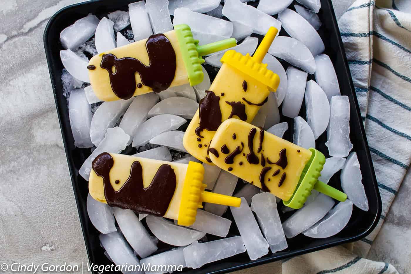 coconut mango popsicles over ice