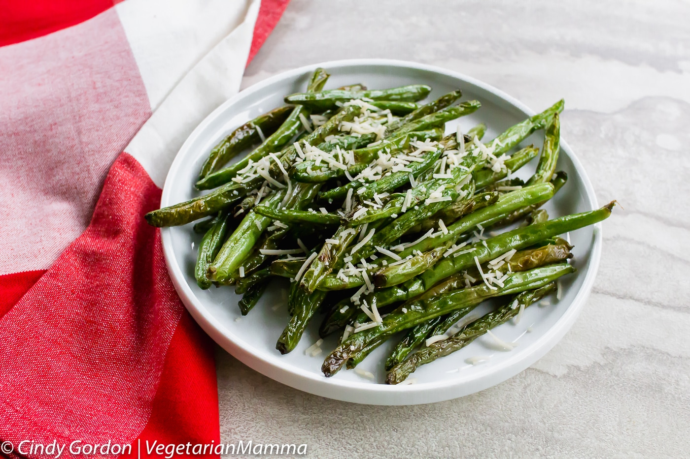 Air Fryer Green Beans can be toped with parmesan cheese.