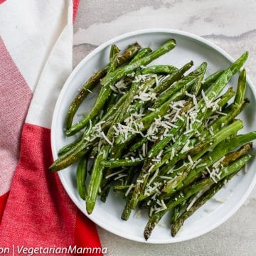 Top down view of Green beans topped with parmesan