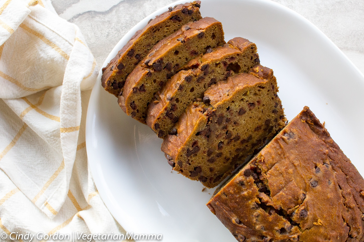 Gluten Free Chocolate Chip Pumpkin Bread is easy to make. Served up in slices.