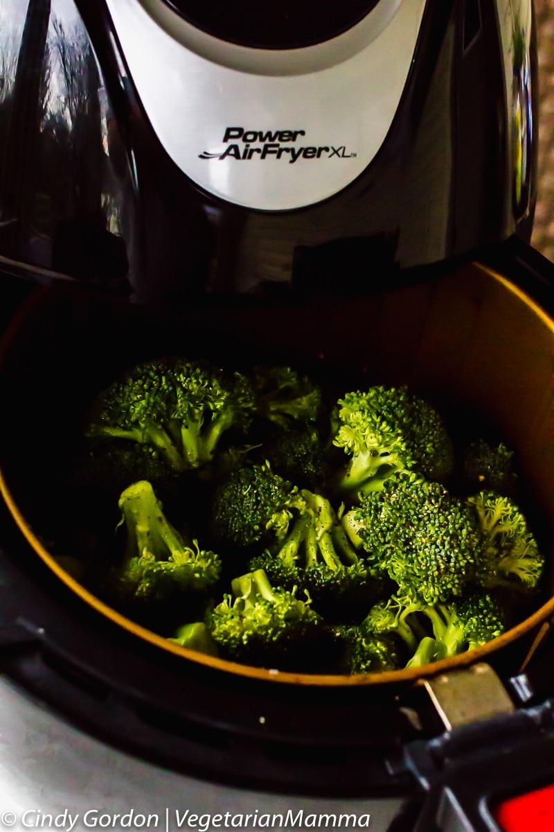 Air Fryer Broccoli in the air fryer basket in a power fryer xl