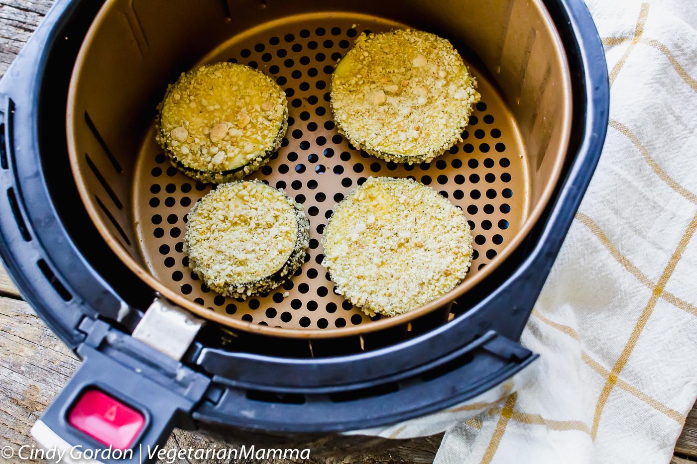 Air Fryer Gluten Free Eggplant Parmesan shown in air fryer basket.