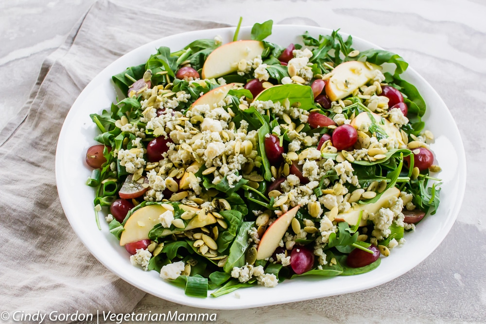 Gorgonzola Cheese and Apple Salad is gluten free and vegetarian on a white platter.