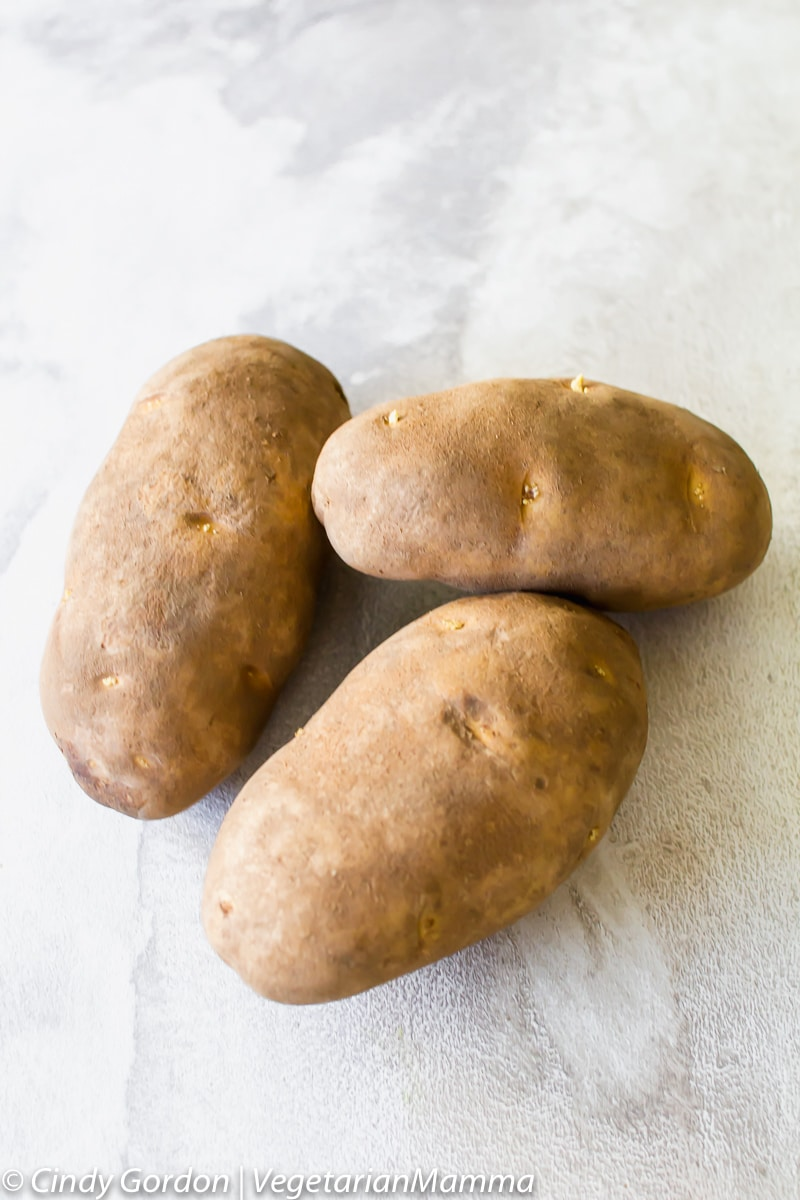three whole potatoes