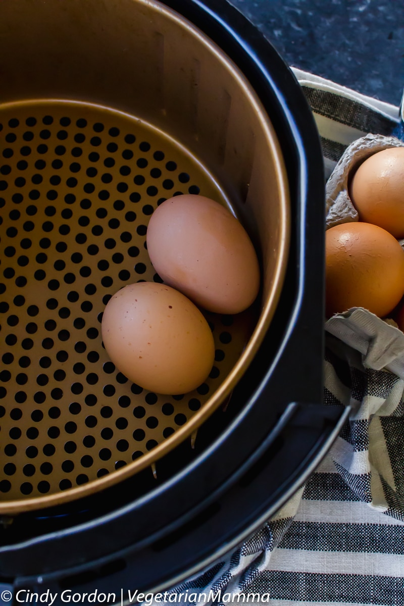 two eggs in an air fryer basket