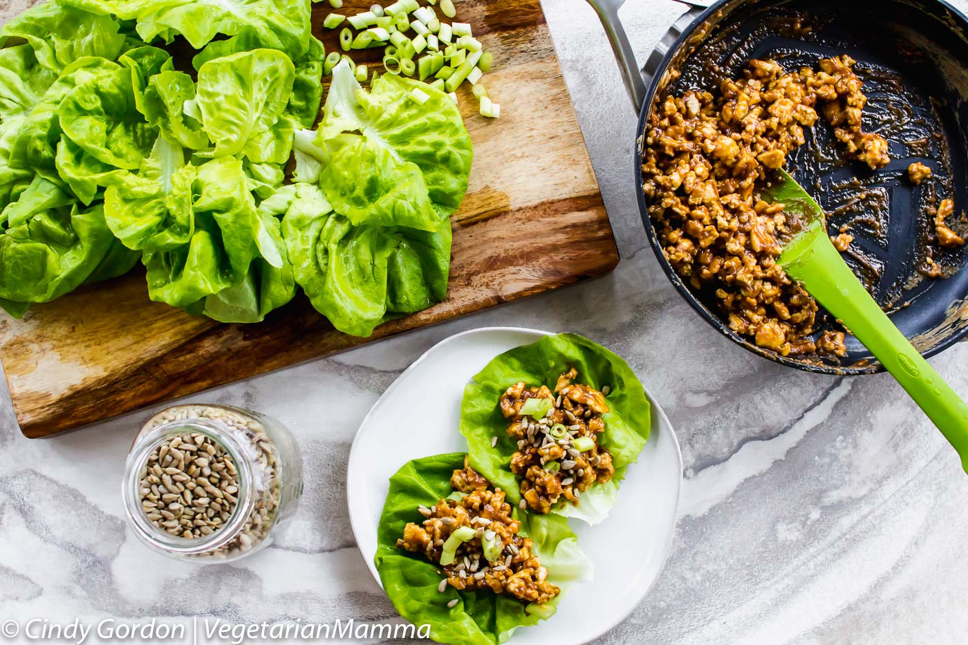 thai lettuce wraps, skilet of mixture and cutting board of ingredients