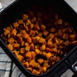 Air Fryer Sweet Potato hash in air fryer basket