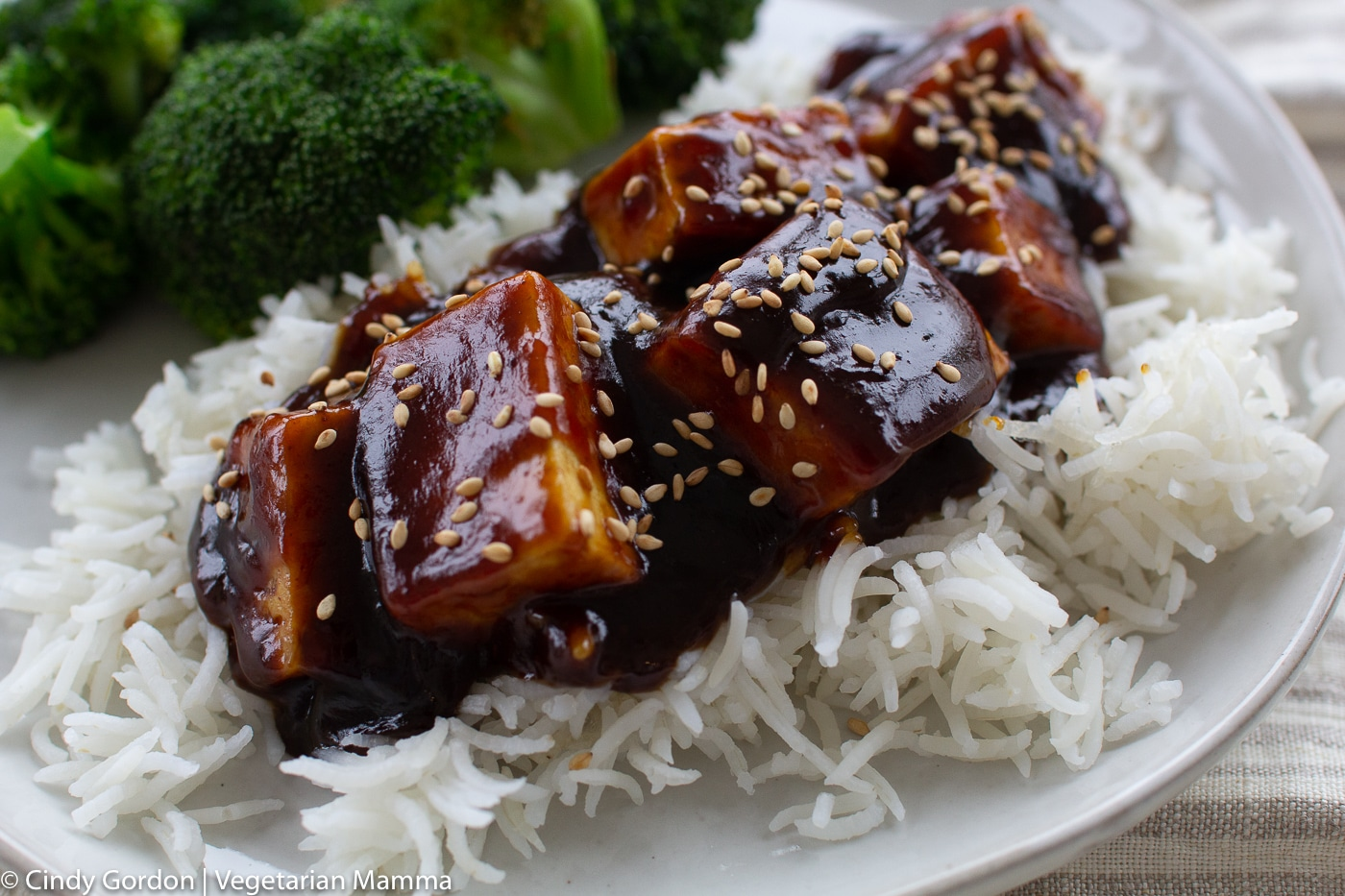 General Tso Tofu with broccoli on a white plate