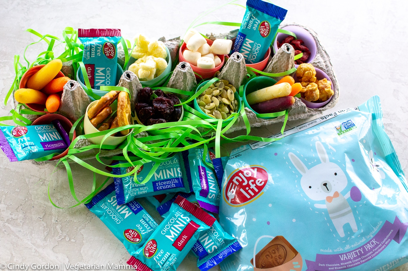 treats in open plastic eggs in an egg carton for easy snacking