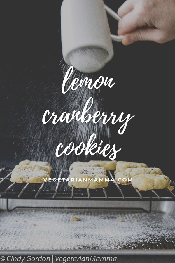 gluten free lemon cranberry cookies being dusted with powdered sugar