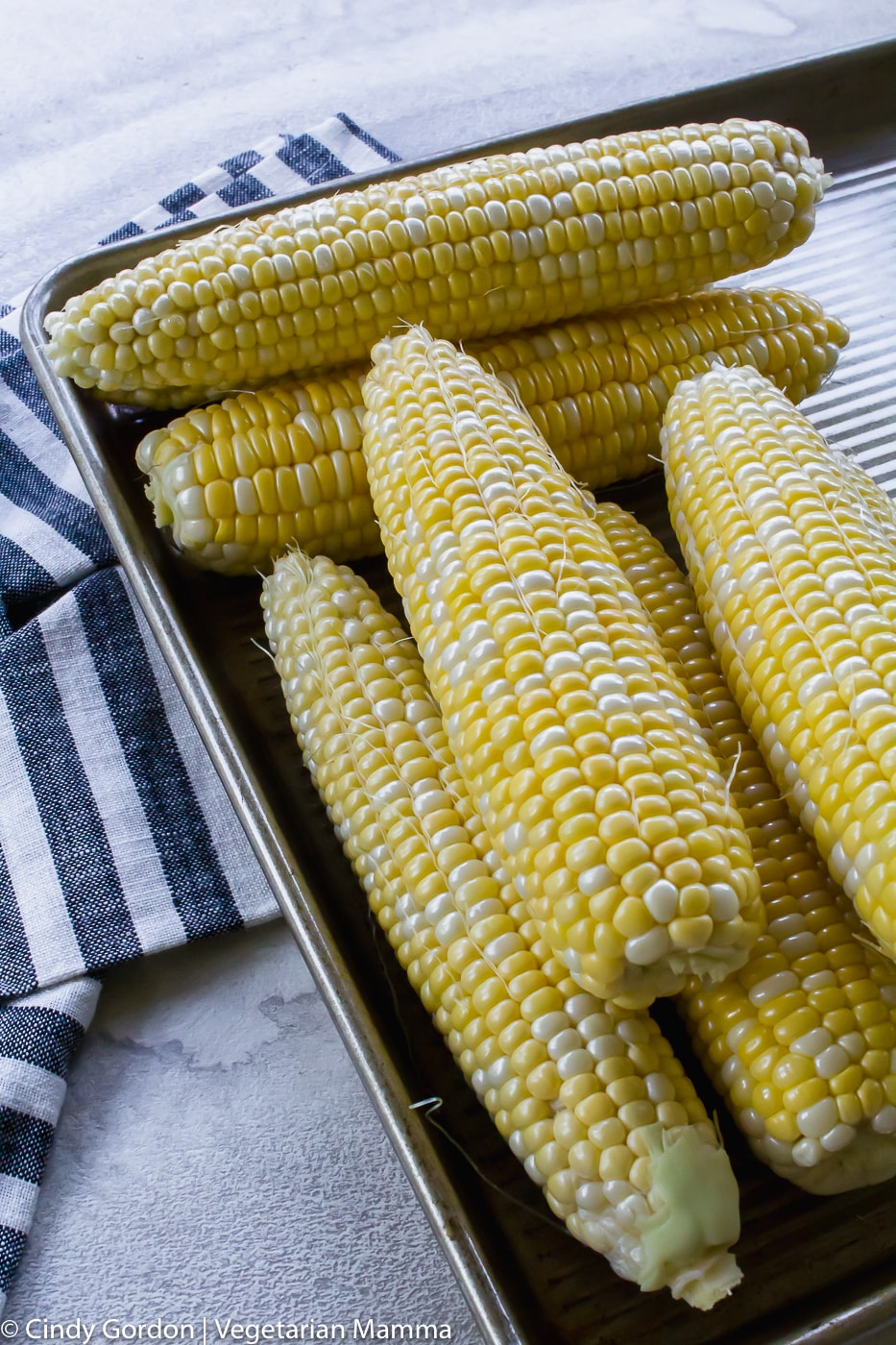 Sweet corn on a baking sheet