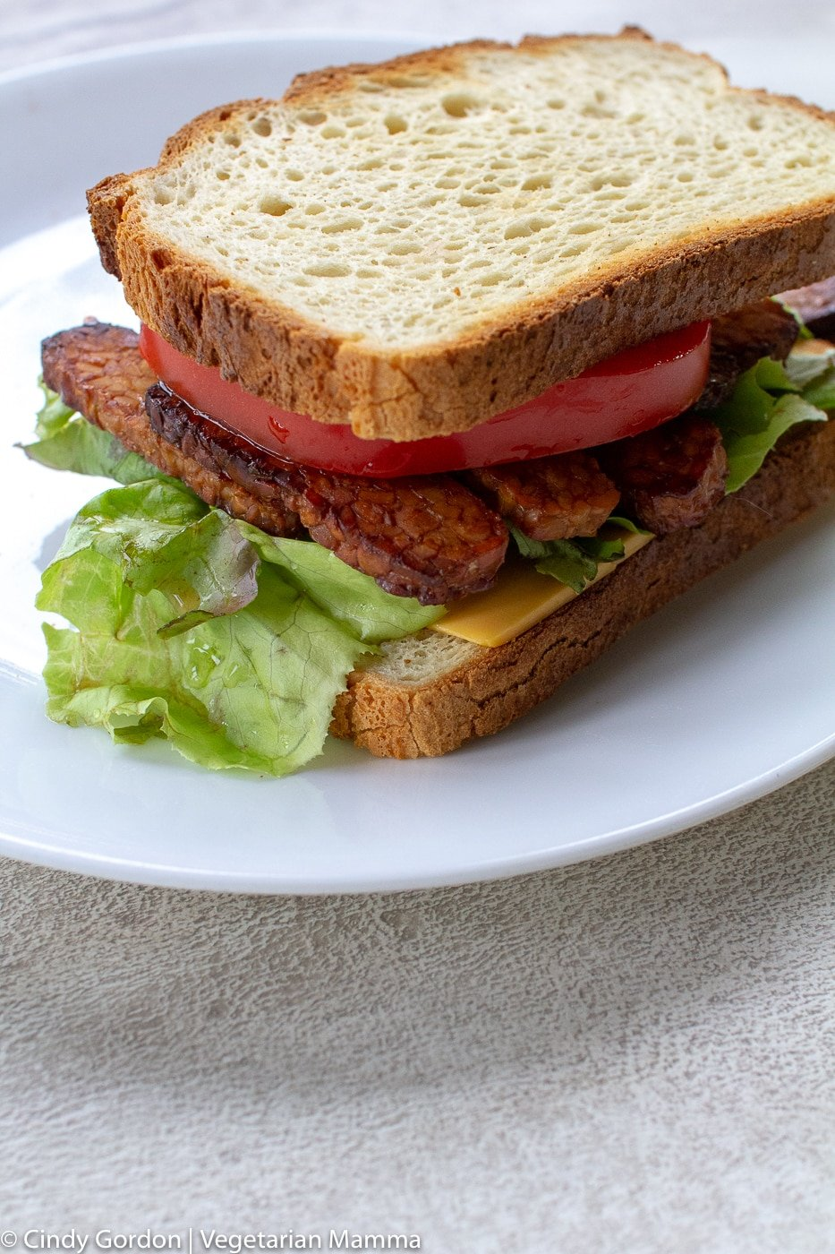 vegan air fryer bacon on a sandwich