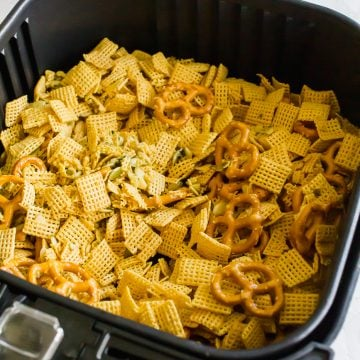 Air Fryer Chex Mix cooked in air fryer basket